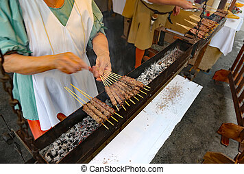 preparation of street food many skewers with lamb meat cooked gr
