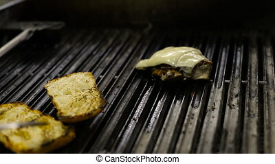 Chef frying chicken and bread for sandwiches on the barbecue