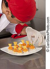 canapes - chef garnishing canapes