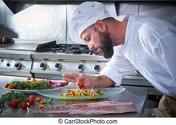 Chef garnishing flower in ceviche dish
