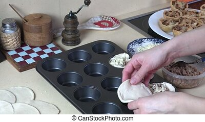 chef hands make tasty appetizer with meat and cheese. -...