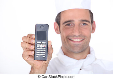 Chef holding a mobile phone
