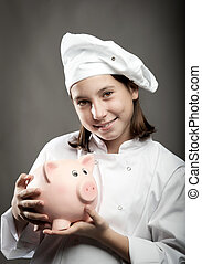 chef  holding a piggy bank