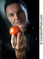 Chef holding a tomato