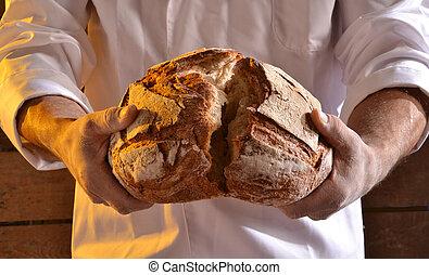 holding a fresh bread