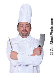 Chef holding meat cleaver and knife sharpener