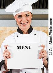 chef holding menu