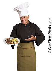 Chef holding plate with roasted meat