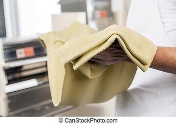 Chef Holding Spaghetti Pasta Sheet
