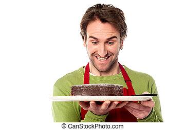 Chef holding yummy chocolate cake