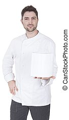 young caucasian chef holds up a toque blanche