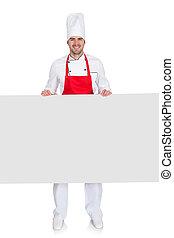 Chef in uniform presenting empty banner