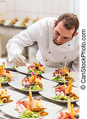 Chef is decorating appetizer dish