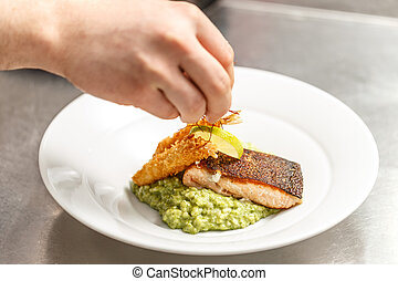 Chef is finishing his plate