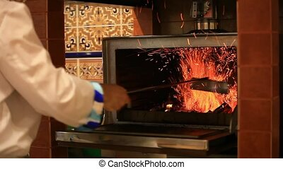 Chef is making flambe and fire. - Chef is making flambe with...