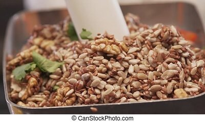 Chef Is Pounding With Mortar Mix Of Seeds And Nuts -...