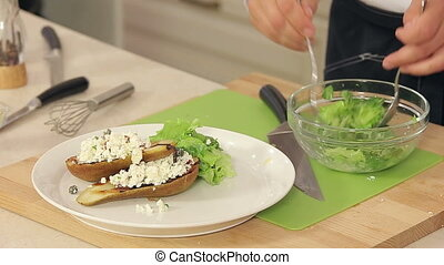 Chef is Putting Salad Mix into a Plate with Grilled Pears and White Cheese