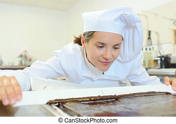 Chef levelling chocolate mixture