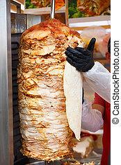 Chef lubricate pita bread
