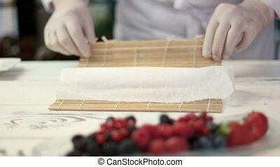 Chef making dessert. Dessert sushi roll.