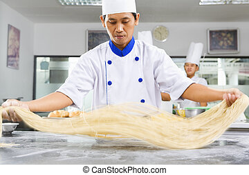 Chef making noodle in the kitchen of cooking school. ***PS :...