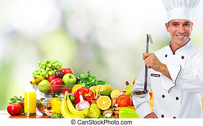 Chef man with vegetables and fruits.