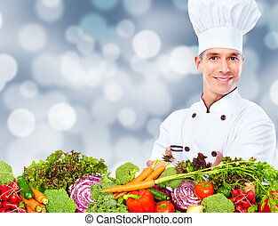 Chef man with vegetables.