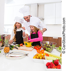 Chef master and junior pupil kid girls at cooking school...