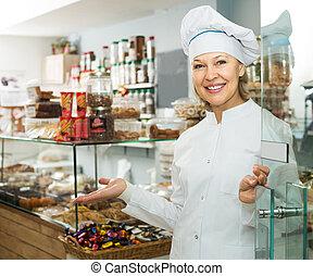 Chef meeting customers at door