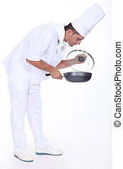 Chef monitoring sauce in pan