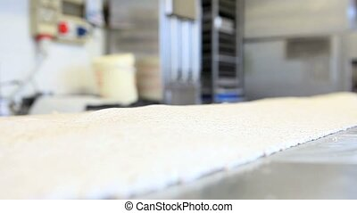 chef pastry hands that cut dough