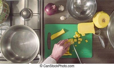 Chef peeling and cutting pumpkin on chopping board
