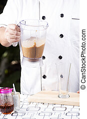 pouring Coffee smoothie to the glass