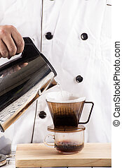 Chef pouring hot water to Fresh coffee