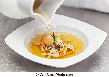 Chef pouring soup