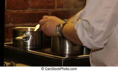 Chef prepare sauce for dish