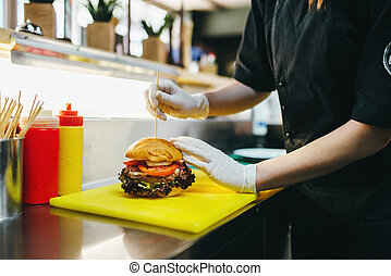 Chef prepares burger, fast food cooking