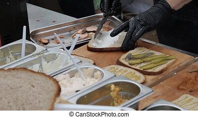 chef prepares sandwich