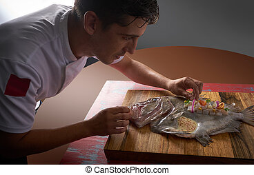 Chef preparing a fish ceviche on board - Chef preparing a...