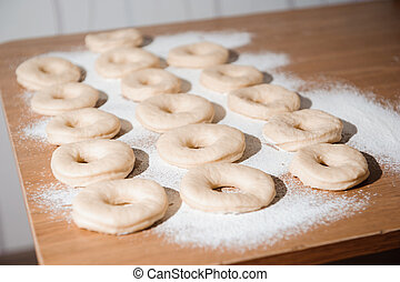 Chef preparing dough - cooking donuts process in the kitchen