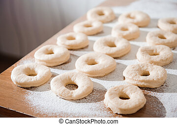 Chef preparing dough - cooking donuts process, work with flour.