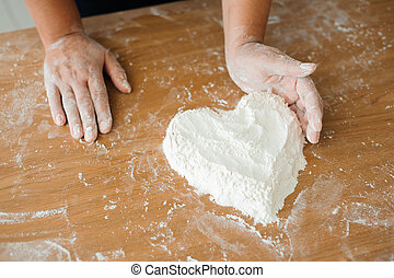 Chef preparing dough - cooking process, work with flour.