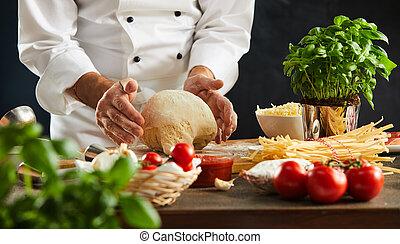 Chef preparing dough for a pizza or pasta