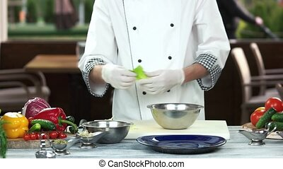 Chef preparing food. Fresh romaine lettuce.