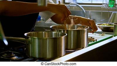 Chef preparing food in kitchen at restaurant 4k