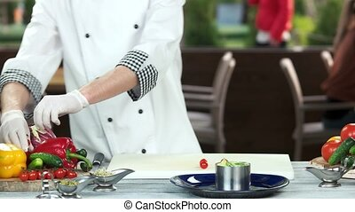 Chef preparing food. Salad with cherry tomato.