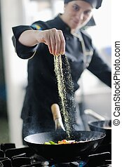 chef preparing meal - beautiful young chef woman prepare and...