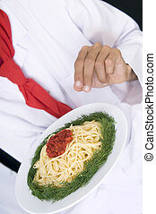 Chef Preparing spaghetti