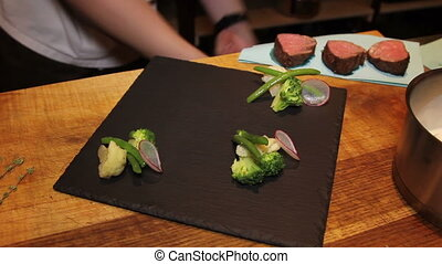 chef preparing tasty diash - beef steak with vegetables