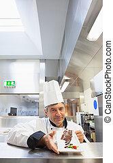 Chef presenting a desert